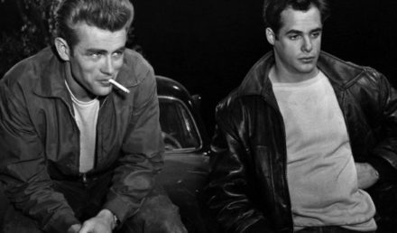 1955 --- Actor James Dean smokes a cigarette beside another actor in a scene from Rebel Without a Cause. --- Image by © Corbis