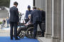 BRUSSELS, BELGIUM - JULY 11: The President of the European Commission, Jean-Claude Juncker is seen seated in a wheelchair as he is brought in through a side entrance of the building where the official dinner for heads of state and government at the 2018 NATO Summit is being held at NATO headquarters on July 11, 2018 in Brussels, Belgium. Leaders from NATO member countries and partner states are meeting for a two-day summit, which is being overshadowed by strong demands by U.S. President Trump for most NATO member countries to pay more towards funding the alliance. (Photo by Jasper Juinen/Getty Images)